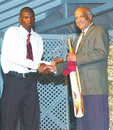 Ramon Senior receives the best bowler prize for his 11 wickets in the CLICO International Under-15 tournament, May 5, 2008