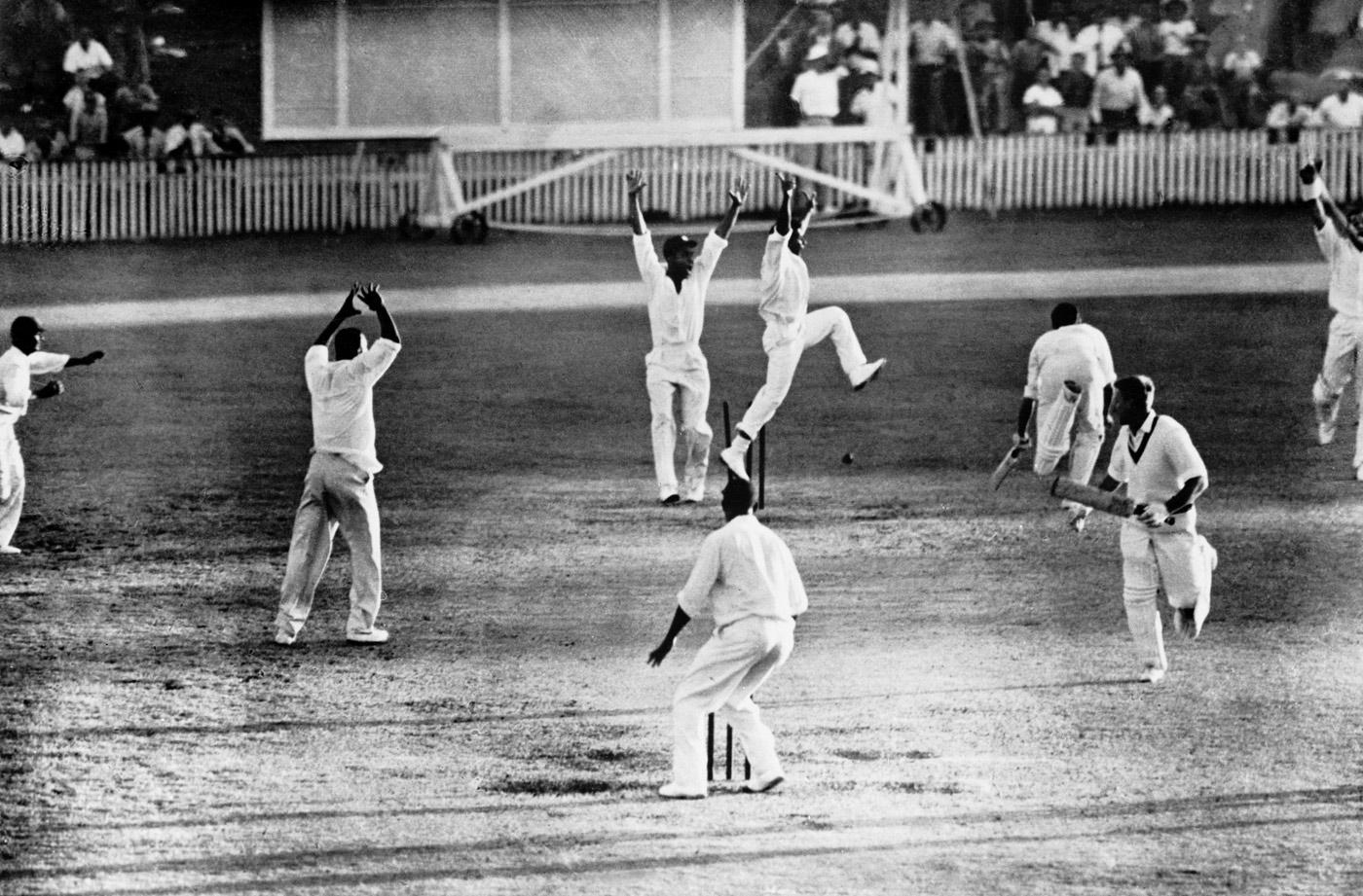 Australian batsman Ian Meckiff is run out to secure Test cricket's first tie