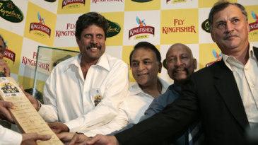 Kapil Dev, Sunil Gavaskar, Syed Kirmani and Roger Binny present an autographed bat