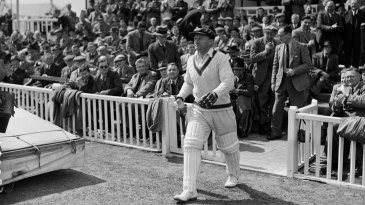 Don Bradman walks out to bat during the tour opener at Worcester