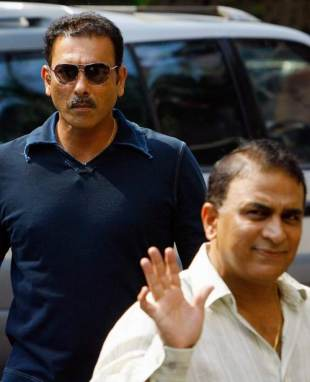 Former India captains Ravi Shastri and Sunil Gavaskar arrive at the BCCI headquarters for a meeting to find reasons for India's World Cup debacle