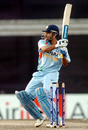 Mahendra Singh Dhoni swivels and pulls