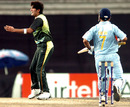 Sohail Tanvir exults after trapping Mahendra Singh Dhoni leg-before