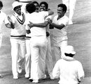 The Indian players celebrate the fall of a wicket