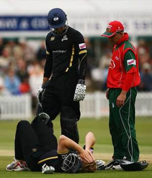 An injured Andrew Gale lies on the ground in pain as Michael Vaughan and Jeremy Snape show concern, Leicestershire v Yorkshire, Twenty20, Grace Road, June 17, 2008