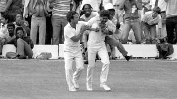 A fan congratulates Kapil Dev for taking a catch to dismiss Viv Richards in the 1983 World Cup final
