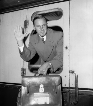 Peter May arrives back from South Africa, Waterloo station, London, March 29, 1957