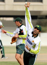 Misbah-ul-Haq bowls in the nets while Geoff Lawson gives instructions in the background, Karachi, July 1, 2008