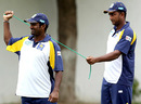 Muttiah Muralitharan does a bit of stretching with the help of Kaushalya Weeraratne, Karachi, July 5, 2008