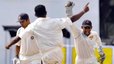 Ajantha Mendis claims his maiden Test wicket after bamboozling Rahul Dravid with a leg cutter