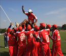 Hong Kong players celebrate their victory over Afghanistan by hoisting their coach Aftab Habib on their shoulders. ACC Trophy Elite, 01.08.2008.<br>  Photo courtesy of Peter Lim / Asian Cricket Council
