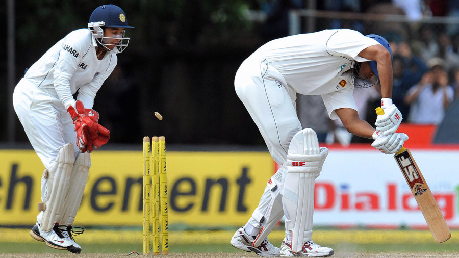 Parthiv Patel stands behind the stumps as Michael Vandort is cleaned up by Harbhajan Singh