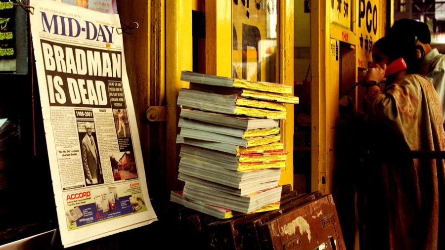 A newspaper headline announces the death of Don Bradman