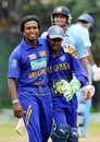 Kaushal Silva congratulates Malinga Bandara on getting Suresh Raina's wicket
