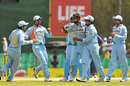 Praveen Kumar is congratulated by team-mates on dismissing Chamara Silva