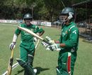Mehrab Hossain jnr and Mahmudullah wait to enter the field