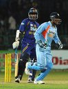 Mahendra Singh Dhoni celebrates the fall of Chaminda Vaas' wicket
