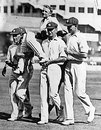 Don Bradman is carried by his team-mates after scoring a record 452
