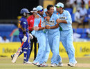 Irfan Pathan celebrates while Mahela Udawatte walks away
