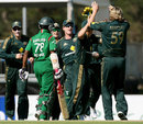 The Australians celebrate Nathan Bracken's second wicket and the exit of Mehrab Hossain jnr