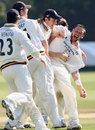 Steve Harmison is mobbed after bowling Martin Saggers to complete Durham's win