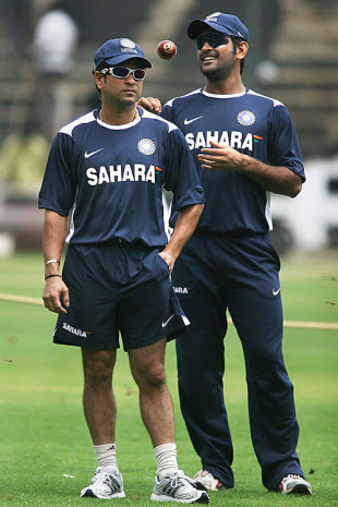 Sachin Tendulkar and Mahendra Singh Dhoni look on during a practice session, Bangalore, September 29, 2008