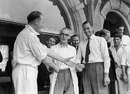 Surrey captain Stuart Surridge, vice-captain Peter May and masseuse Sandy Tait shake hands, August 26, 1955