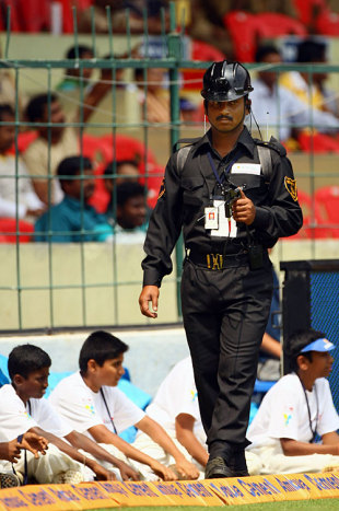 A security official walks around the ground with a bomb detector, India v Australia, 1st Test, Bangalore, 1st day, October 9, 2008