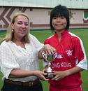 Chan Sau Har (Charlotte) receives her Player of the Match award from Julie Atkinson. HK Women v. JP Women, KCC, 10.10.2008