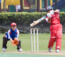Betty Chan hits the ball over cover to the fence. HK Women v. Japan Women, HKCC 09.10.2008