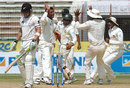 Abdur Razzak celebrates with his team-mates after dismissing Brendon McCullum