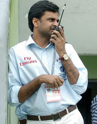 Javagal Srinath, the match referee, talks on his walkie talkie, Bangladesh v New Zealand, 2nd Test, Mirpur, 3rd day, October 27, 2008