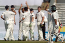 The New Zealand team celebrates the dismissal of Mehrab Hossain jnr