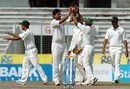 Mashrafe Mortaza is congratulated by team-mates after dismissing Jamie How, Bangladesh v New Zealand, 2nd Test, Mirpur, 5th day, October 29, 2008