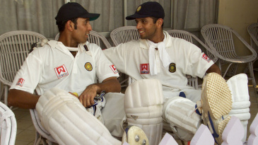 VVS Laxman and Rahul Dravid relax after their 376-run partnership