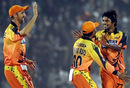 The Ahmedabad Rockets' players celebrate a wicket