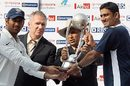 Mahendra Singh Dhoni and Anil Kumble hold aloft the series trophy presented by Allan Border and Sunil Gavaskar