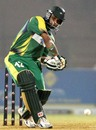 Imran Farhat readies to smash the ball