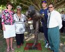 Judy Spence, Valda Coolwell, Matthew Hayden and Larry Budd pose after the unveiling of a statue of Eddie Gilbert, Allan Border Field, Brisbane, November 16, 2008