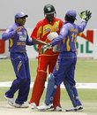 Kumar Sangakkara and Mahela Jayawardene celebrate a Zimbabwe wicket