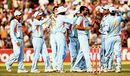 Team-mates congratulate Zaheer Khan on dismissing Alastair Cook