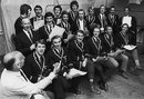 Brian Johnston conducts the English team in a rendition of 'The Ashes Song', London, April 19, 1971
