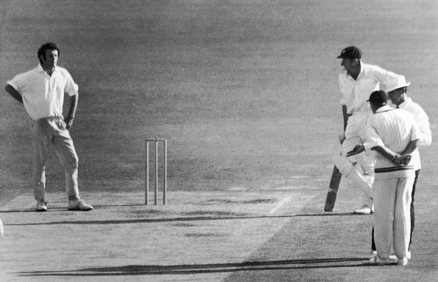 His bowler's keeper: Illingworth has a word with umpire Lou Rowan, who repeatedly pulled up John Snow (looking on at left) for hostile bowling in Perth in 1970