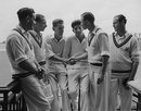 Peter Loader is congratulated by David Fletcher (standing) for his 8 for 21 as Bernie Constable, Arthur McIntyre, Ken Barrington and John McMahon look on, Surrey v Worcestershire, County Championship, 2nd day, The Oval, July 16, 1953