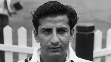 Fazal Mahmood takes a cigarette break during a match