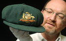 The auctioneer, Charles Leski, inspects the Baggy Green cap worn by Don Bradman during the 1948 'Invincibles' tour. It is expected to make more than AUS$600,000, Melbourne, December 2, 2008