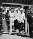 Umpires Ronald Wright and George Cooper walk on to the field on Boxing Day, Australia v England, MCG, 3rd day, December 26, 1950