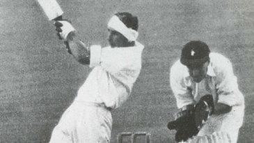 Bert Sutcliffe lofts Hugh Tayfield for a six