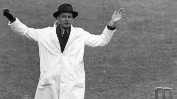 Umpire Frank Chester signals the only wide of the game
