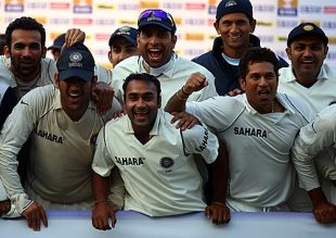 The Indians celebrate their 1-0 series victory after drawing the second Test against England in Mohali